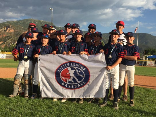 Dixie's U-12 baseball team is all smiles as it poses