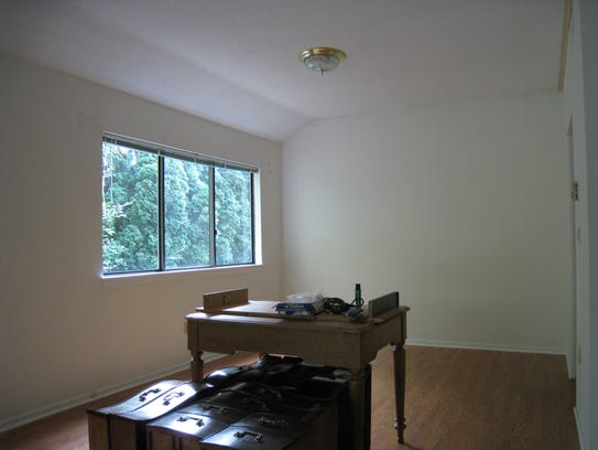Before staging: The dining room in Hal Workin's condominium