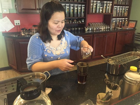Lily Lin pouring tea at Finger Lakes Tea Co.