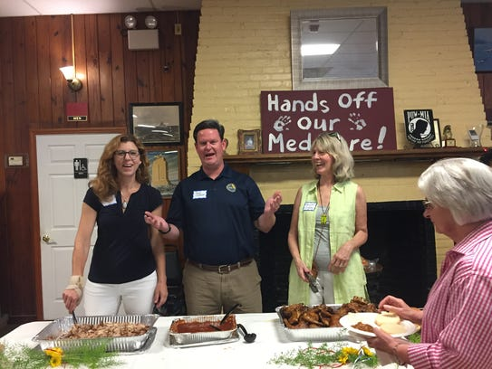County Commissioners Kristin Dozier, John Dailey and