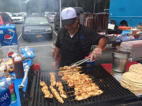 Pete Delcado of Gena Food Concessions turns chicken