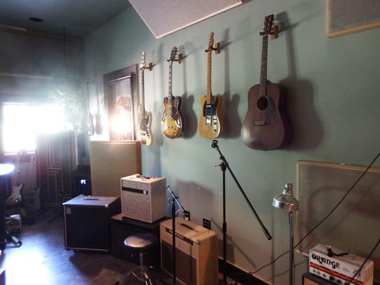 Guitars hang on the walls inside Lone Tree's Flat Black