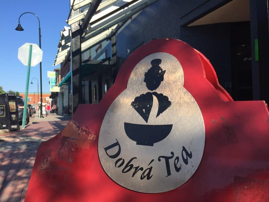 A sign on the Church Street Marketplace promotes Dobra