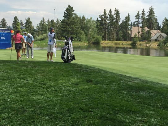 JJ Henry makes a putt on the 18th green at Montreux