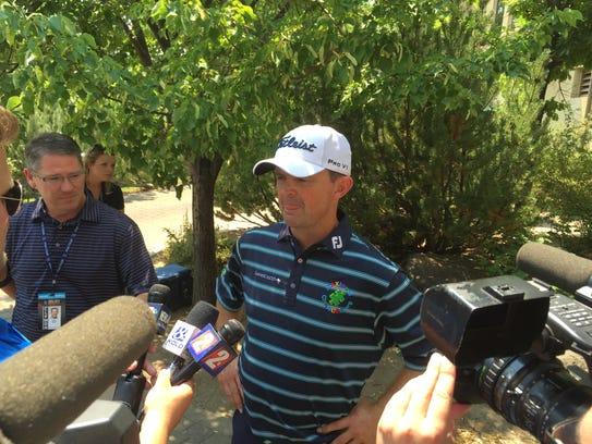 Defending champion Greg Chalmers talks to tne media