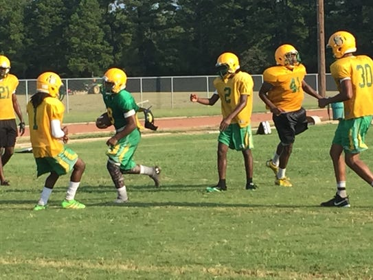 Green Oaks players run a play on Friday.