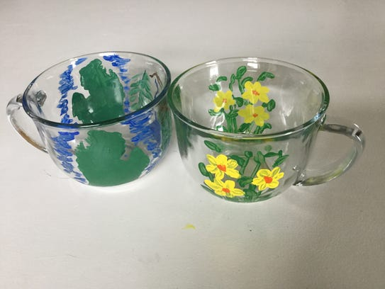 Decorate a soup bowl at the Community Sharing booth