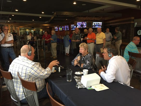 Paul MIller, left, and Bill Gilmer speak with former