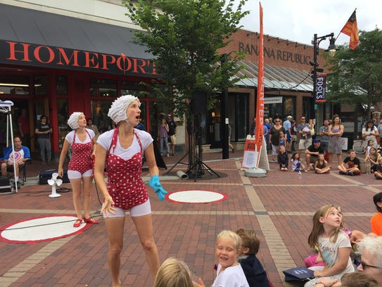 The Kif Kif Sisters perform on Church Street at the