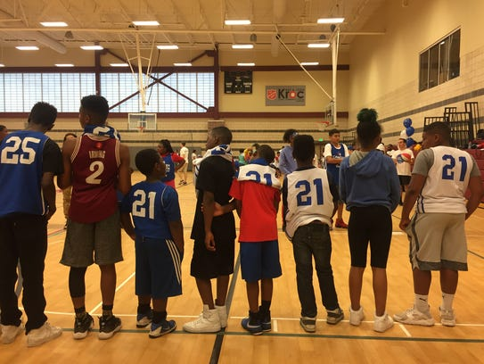 Players line up before a drill at the Sixers' youth
