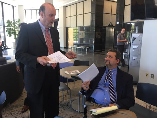 Macomb County Corporation Counsel John Schapka, left, talks with attorney Frank Cusumano Jr., the attorney for embattled county Clerk Karen Spranger, at a news conference last year in Mt. Clemens.