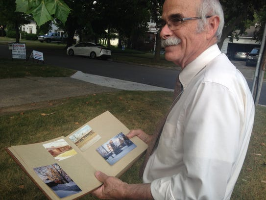 David Peters looks through a photo album that shows
