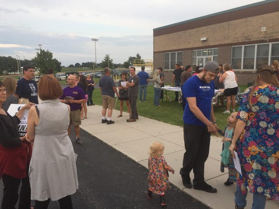 Area residents gather outside Kennard-Dale High School