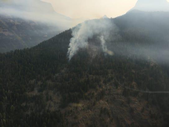 The Sprague fire burns in Glacier National Park earlier