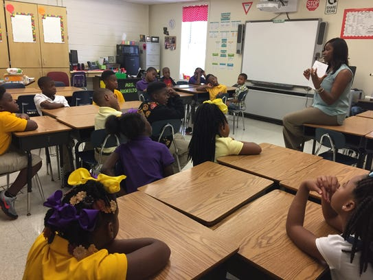 Amecia Hamilton talks to her third-grade class Monday