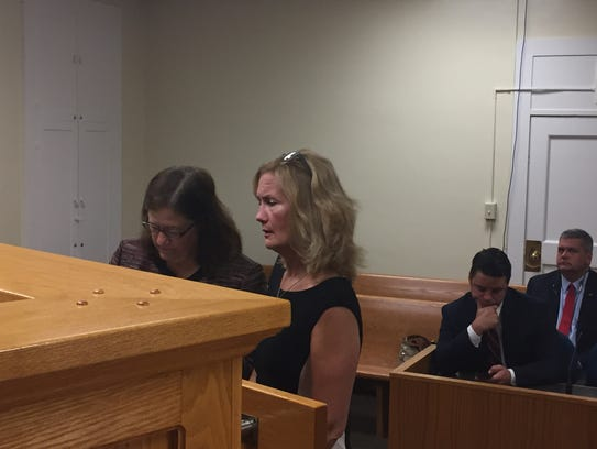 Michele Ryan, right, entered not guilty pleas to two