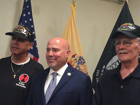 Army veterans Garfield Harper Jr. of Westampton, left,
