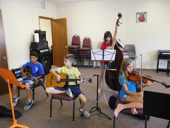 Campers learned chords on the ukulele and put them