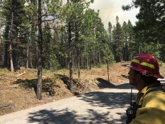 Jose Morquecho of Mattawa, Wash. monitors a wildfire