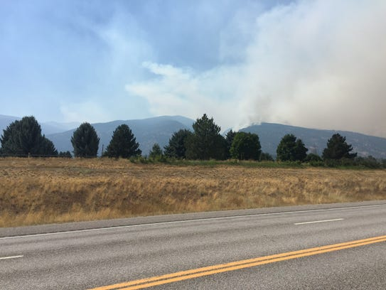 The Lolo Peak fire is within a mile of U.S. Highway