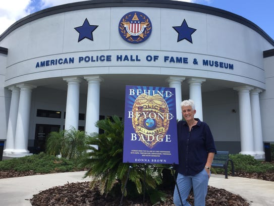Retired TPD officer and author Donna Brown poses at