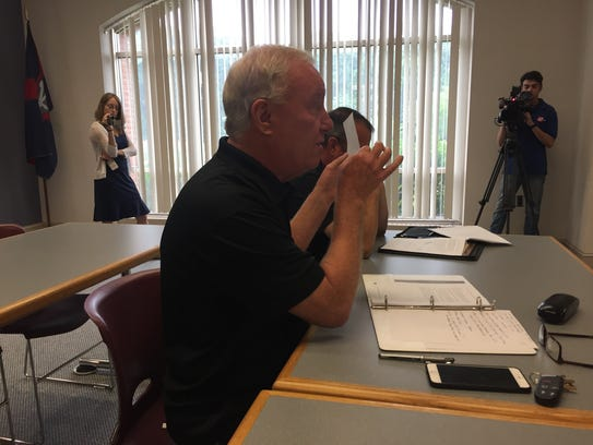 Ocean City Mayor Rick Meehan holds up a document as