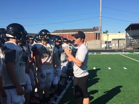 Silverton coach Josh Craig talks to his team during