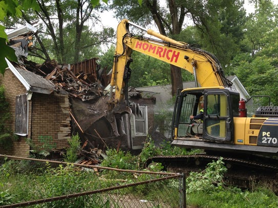 In this June, 2015 photo, a contracted demolition crew