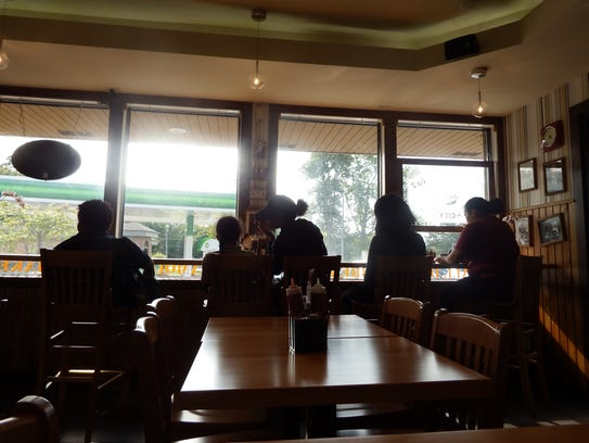 Customers sit at a long table inside the new Hamburg