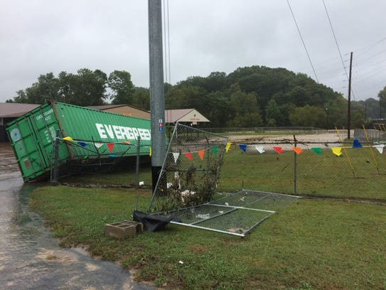 Floodwaters from nearby Sulphur Fork Creek damaged