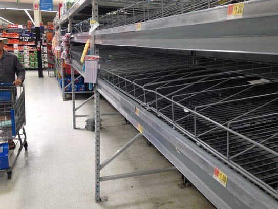 In this 2017 file photo, shelves normally stocked with bottles of water were empty days before Hurricane Irma hit.