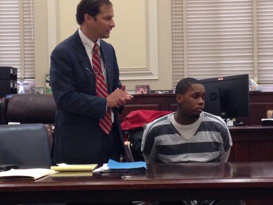 Donteiz Dickey, sitting next to his attorney, Scott