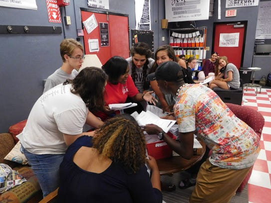 Kelsey Gilmore (center) encourages her group to share