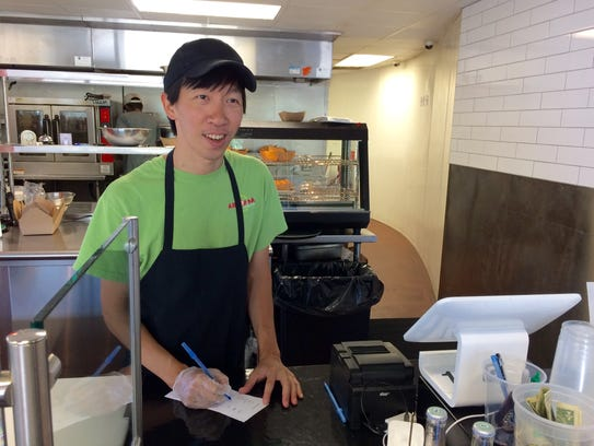 Nam Vu working the counter at Arepana.