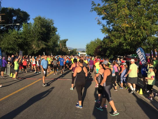 Runners head to the start line of the 49th annual Journal