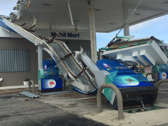 Damage to the Mobil Mart gas station in Indialantic.