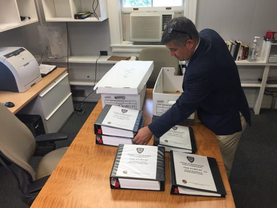 Mamaroneck Detective Richard Carroll shows some of