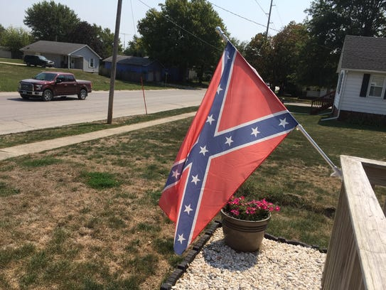 The Confederate flag flies in front of Kathy Myers'