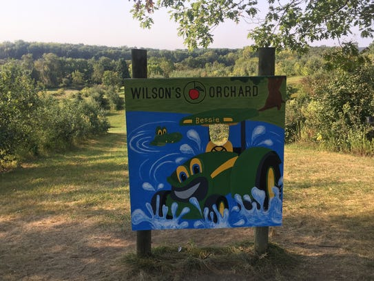 A cut-out photo board is set up at Wilson's Orchard