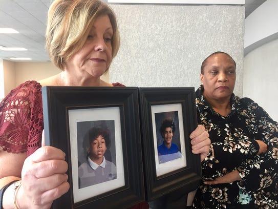 Debbie Wren stands beside Jackie Partee holding pictures