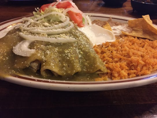 Enchiladas with rice and refried beans served Monday,