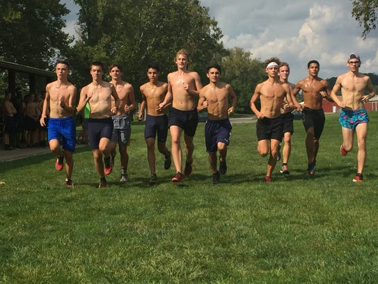 The Lancaster boys varsity cross country team prepares