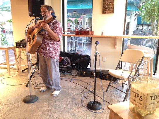 Papa Tommy plays original songs during the open mic