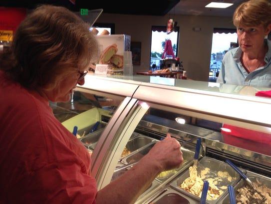 Carol Tichy orders a homemade gelato from an employee