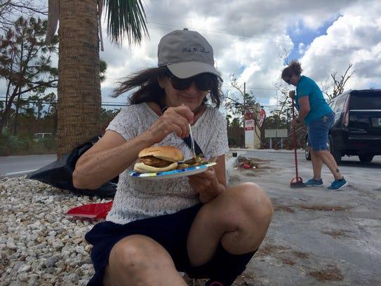 Angela Garcia eats a donated  meal on Big Pine Key,