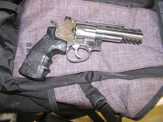 A silver BB gun revolver was located in a backpack