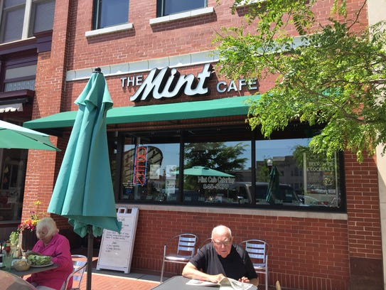 Customers enjoy their lunch outside of The Mint Cafe,