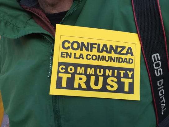 Members of the Community Trust Coalition wore stickers