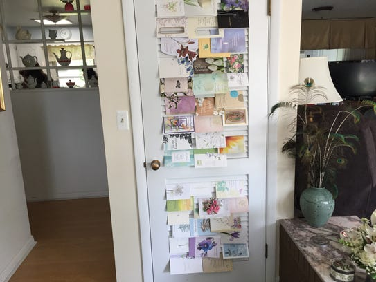 Sympathy cards decorate doors inside the home of Alvaro
