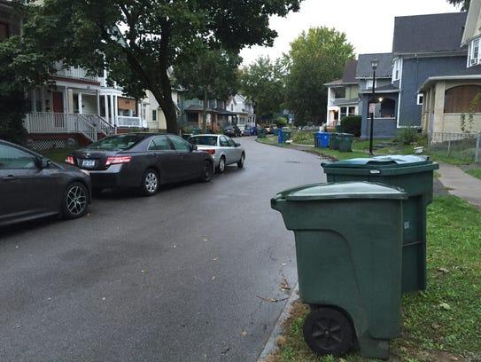 Woodlawn Street, a residential road near Monroe Avenue